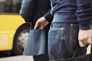 Pickpocketing on the street during daytime