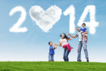 Happy family celebrate new year 2014 outdoor