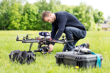 Engineer Setting Camera On UAV Helicopter