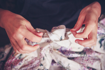 Close up on woman's hands sewing