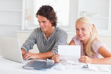 Happy couple doing their accounts