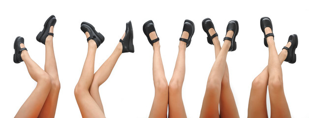 Beautiful woman legs and black shoes pointing up isolated