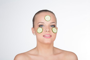 Wonderful cucumber mask for a pretty young girl