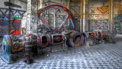 Old steam engine with graffiti