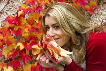 Beautiful woman with colorful leaves