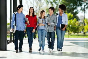 College Students Walking Together On Campus