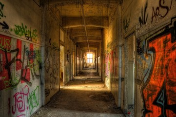 Abandoned corridor with graffiti