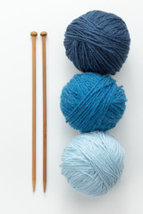 Knitting yarn balls in blue tone and needles