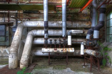 Wall Mural - Old pipes with valves