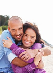 Wall Mural - Happy smiling middle-aged couple on a beach