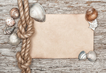 Ship rope, shells, sheet of paper and old wood