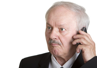 Senior businessman on the phone looking surprised