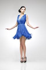 brunette in blue dress