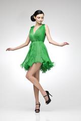 brunette in green dress