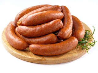 Sausages on round kitchen cutting board