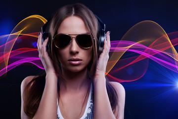 woman DJ enjoying the music in the headphones