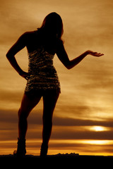 woman silhouette hand out shiny dress