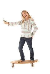 Young girl skateboarding taking selfies