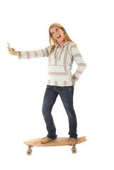 Young girl skateboarding taking selfies