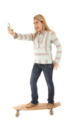 Young girl on skateboard taking picture of herself smiling