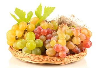 Ripe sweet grape in basket, isolated on white Fototapete