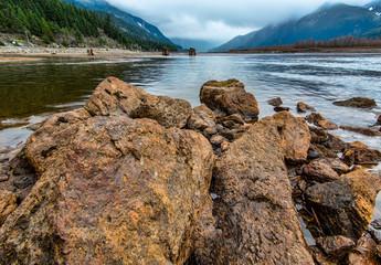Fototapete - Rocks Along Shore of Lake