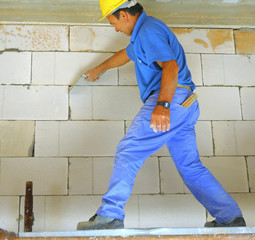 construction worker performs an internal bricklayer wall