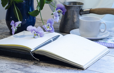Still life with a notebook and pen