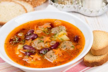 Soup with meatballs and red beans