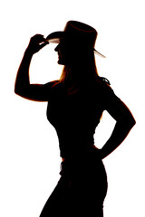 silhouette woman cowgirl side hand hat close