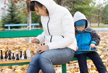 Woman enjoying a game of chess outdoors
