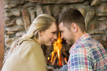 Romantic couple in front of fireplace