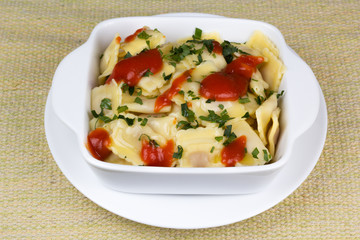 Italian pasta, ravioli with parsley and sauces