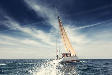 Sailing ship yachts with white sails Wall mural