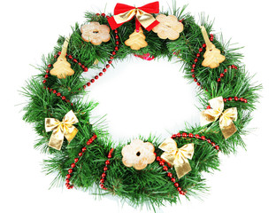 Christmas wreath decorated with cookies isolated on white