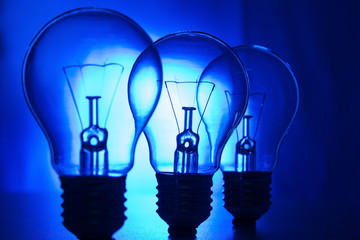 Row of light bulbs on a bright blue background