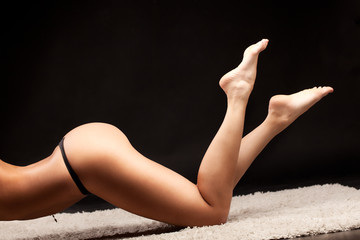 Picture of a sexy woman lying over dark background