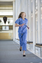 Nurse running down hospital corridor