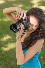 High angle view of brunette young woman taking a picture
