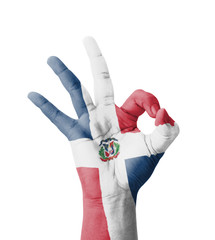 Hand making Ok sign, Dominican Republic flag painted