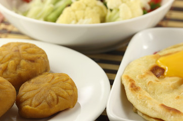 Parotta with barfi and vegetables