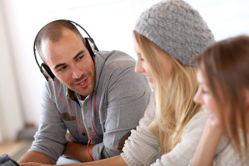 Friends having great time listening to music