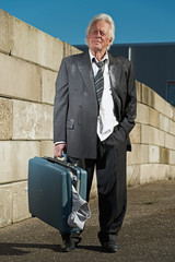 Depressed senior business man without a job and homeless on the