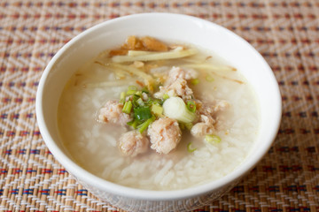rice soup with pork on mat