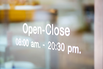 Open and Closed Sign on glass door