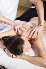 Bodybuilding, Beautiful brunette woman getting a massage