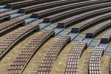 Rows of seats in the open air auditorium hall