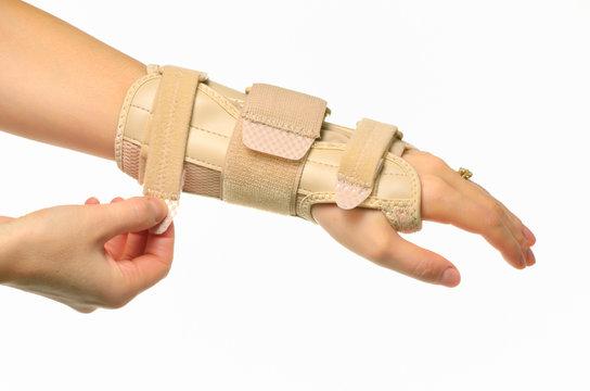 hand with a wrist brace