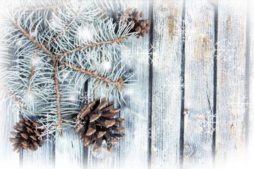 christmas fir tree with pinecones on a wooden board