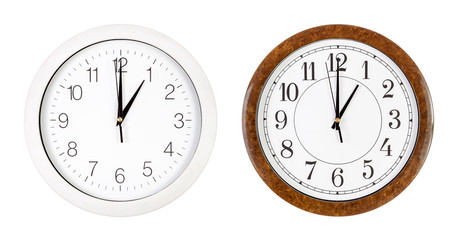 Two clock faces showing one o'clock